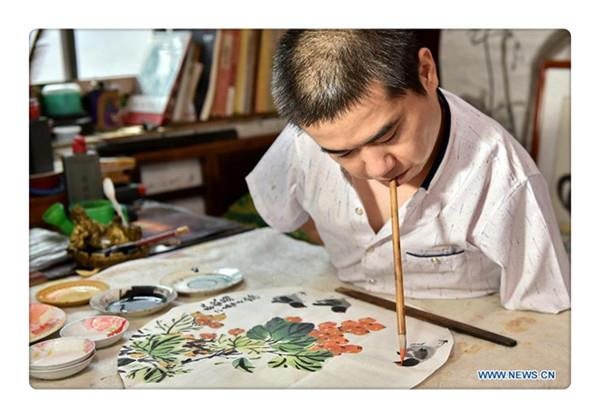 Disabled man learns traditional Chinese art